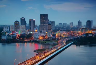 The Malaysian city of Johor Bahru, with heavy traffic on the Johor-Singapore Causeway at dusk.